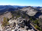 Tsum Peak summit view. My sons are above the rocks near center.