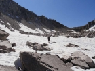 Crossing snowfields as we drop into the Flytrip Basin.