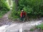 First creek crossing and about to lose a trekking pole.