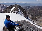 Taking a break above the crux, Lost River Range in the distance.