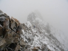 Getting pelted with wind and snow on the summit ridge.