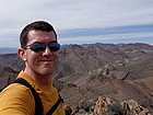 Me on the summit of Corkscrew Peak, with Thimble Peak in the background.