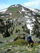 John leaving Pk 7859' with Council Mountain in the background.