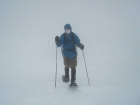Nearing the summit in the fog and wind.