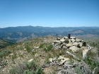 The view across the summit cairn with Shaffer Butte and Mores Mountain in the background.