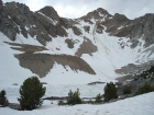 A mostly frozen Pass Lake, with Peak 11967' above.