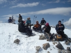 The group having a snack on the summit of Little Sister.