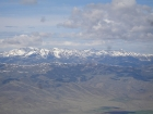 The snow covered Pioneer Mountains can be seen to the southwest.