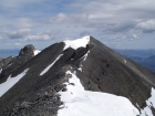 From the false summit atop the Super Gully, it's a fun ridge walk to get to the true summit. Pat is on the snow in the distance.