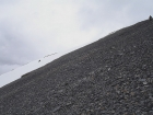 This is George glissading down the step snowfield from the west ridge. John is in the upper right scree skiing.