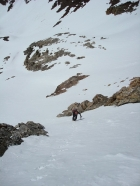 John carefully making his way up the snow vein.