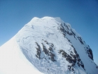 The scary summit block. Steep snow on a knife-edge ridge with cornices overhanging on both sides.