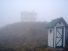 A foggy view of the summit buildings.
