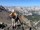 Dave surveying the views from Decker Peak, Cramer Lakes below. John F photo.
