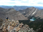 Just a few moves below the summit of WCP-5, Swimm Lake in the background.