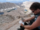 Signing the summit register on Mount Muir.