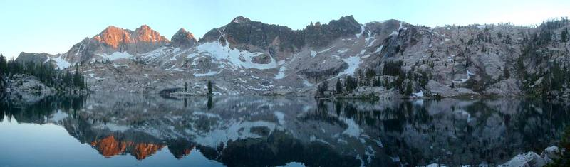 Panoramic view from Lake Kathryn, highlighted by alpenglow on Elk Peak.