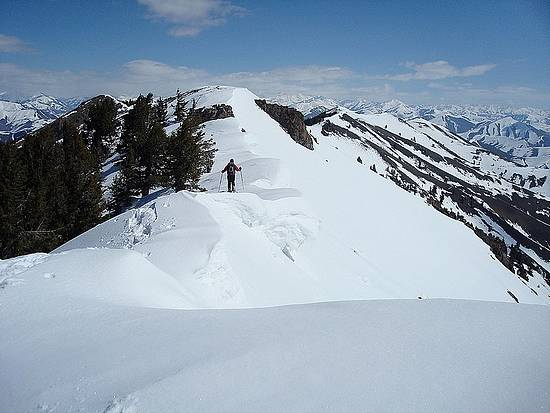 John crossing cornices on the northeast ridge of Kelly Mountain.